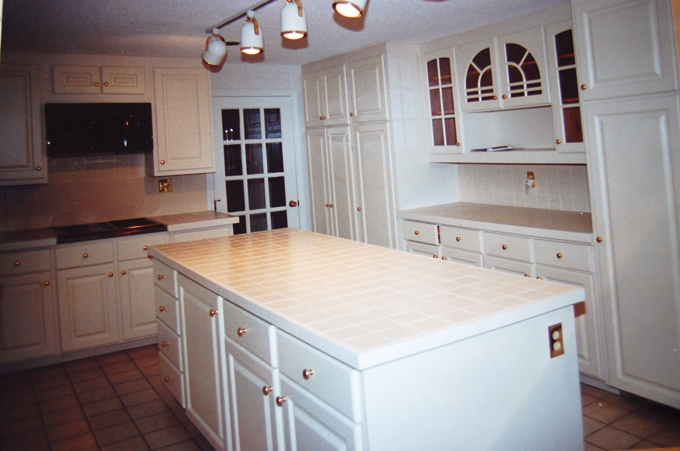 Should i refinish or replace my cabinets weiler painting
